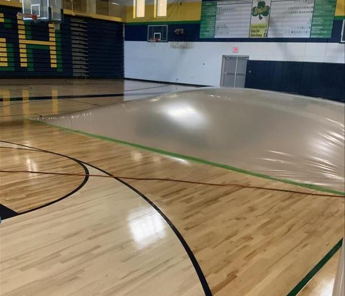 high school gym floor with a plastic covering