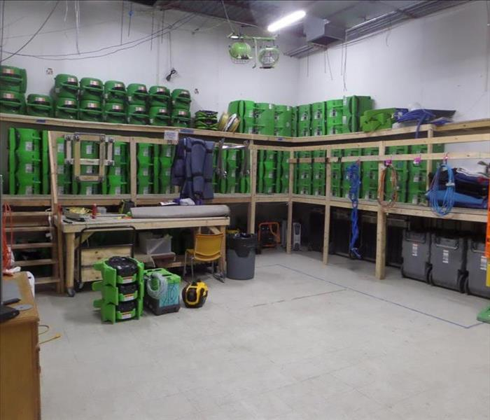 SERVPRO equipment stacked on shelves