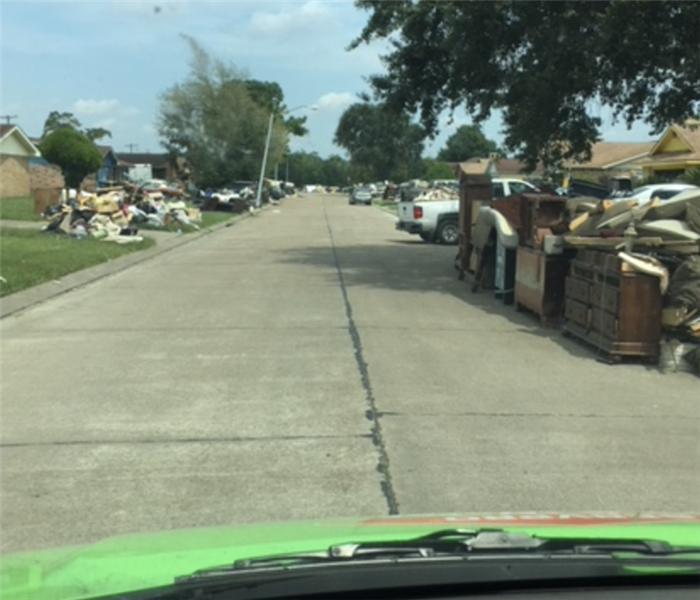 damaged materials up and down residential road
