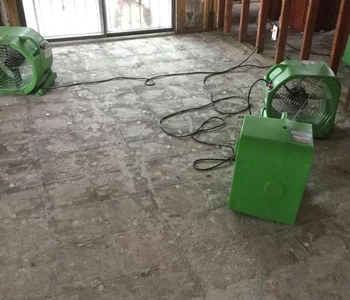 SERVPRO fans on concrete floor