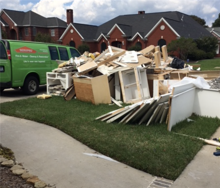 damaged building materials on front lawn