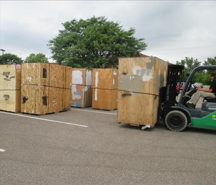 contents being moved in wood boxes